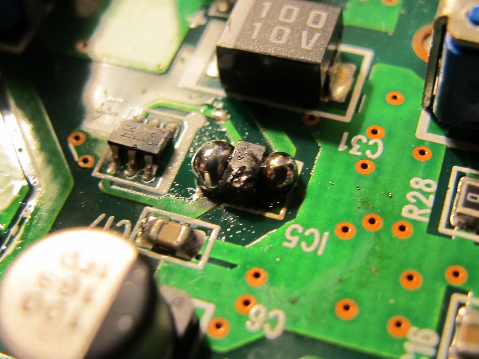 Blobs of solder around IC5