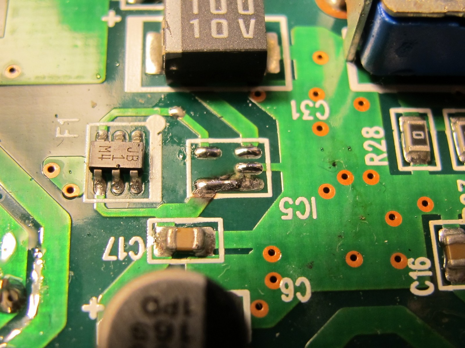 Burned PCB traces below IC5