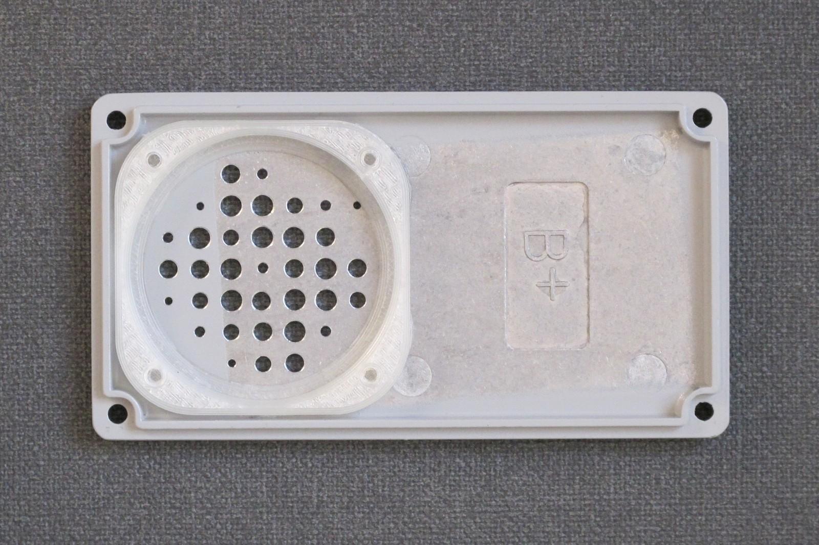 Glued speaker holder
